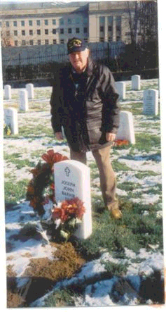 John McAuliffe at his friend <br /> Joseph Barvir's gravesite in <br /> Arlington National Cemetery, VA<br /> December - 2003.<br /> <br /> ...And at the going down of the sun...<br /> We shall remember them..