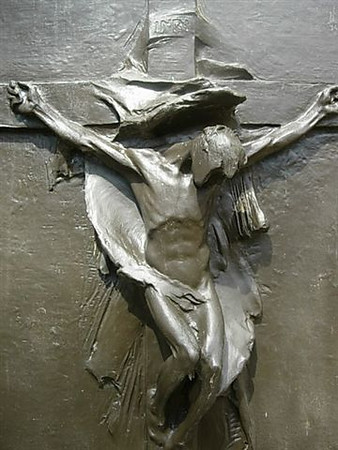 "Per Mr. John McAuliffe:<br /> <br /> This crucifixion plaque was sculptured by my Dad, Florence McAuliffe for his father's  gravestone...Timothy J. McAuliffe (also a sculptor).<br /> <br /> After 60 years it had gathered a deep stained green patina.....<br /> <br /> I spent hours removing it and applying a bronze laquer stain and a sealant spray over that.<br /> <br /> To see all photos submitted from many about the 87th Infantry Division, or to submit yours, go to:<br />  <a href=""http://history06.smugmug.com"">http://history06.smugmug.com</a><br /> <br /> and <br /> <br /> For info on 87th Infantry Division Association:<br />  <a href=""http://www.87thinfantrydivision.com"">http://www.87thinfantrydivision.com</a>"