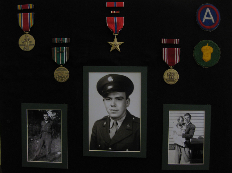 "Sgt. First Class Richard Leonard Butler Shadow box:<br /> <br /> <br /> Joel Tumlin contacted the 87th gallery asking about info on his great Uncle:<br />  Sgt. First Class Richard Leonard Butler:<br /> <br /> I am researching my Great Uncle's time in the war.<br /> He served in the 549th AAA AW.<br /> From your photo gallery/info on Battery C – <br /> I see that he was not in this Battery.<br /> <br /> Richard died when I was three years old. <br /> <br /> Here is the most accurate information I have on my great uncle.  <br /> All of this information about Richard comes from his youngest brother, Robert O. Butler, who passed in 2006. <br /> Bob gave me all of Richard's medals from WWII.  <br /> I have them along with several of his pictures in a shadow box in my home.  I have two young daughters that I want to tell as much about his service to this great country as possible.  I am aware that many of that generation do not consider themselves as heroes.  <br /> I have a different opinion.  <br /> This country is the greatest on earth because of their sacrifices.<br /> <br /> I want to know all I can about my great Uncle's service.<br /> Please post these photos and information. <br /> I hope to discover what Battery of the 549th that Richard did serve with,<br /> Maybe someone who knew him, who served in the same Battery,<br /> Or who could guide me to find more information. <br /> <br /> Around two years ago, I e-mailed a gentleman named Walter Clarke who told me he was in the 549th AAA HQ Battery, Medical Detachment- he added Btn Surgeons Assistant, Lt., Medical Officer.  <br /> He gave me some information about the units activity during the Battle of the Bulge and the fight for Metz, France. <br /> I can not find anything more than this.<br /> <br /> I know that there was a fire that destroyed many military records in St. Louis around 1973.  I do not know if any of Richard's records could be found elsewhere or if they exist. <br /> <br /> I want to honor this relative, who probably would just say he did nothing extraordinary, but just did his job.  <br />  <br /> Thanks from One Proud American,<br />  <br /> Joel Tumlin<br /> Chelsea, Alabama <br /> 35043 <br /> jtgobama (at) hotmail.com<br /> <br /> ====<br /> <br /> Richard Leonard Butler DOB 4-2-24 in St. Louis, MO.<br /> He graduated from high school in 1941.  <br /> He worked briefly at Brashear Truck Lines before he was drafted in 1941 at age 18.  <br /> <br /> He was assigned to the 549th AAA Bn and trained at Camp Edwards, MA.  Richard was not selected to participate in the D-Day landing.  <br /> He was billeted in ""Littlecote Manor"" during his stay in England.  <br /> Later, he entered France through LeHavre and was assigned to Patton's Third Army.  He was awarded the Bronze Star for his action during the Battle of the Bulge.  <br /> <br /> Uncle Bob said that Richard had a copy of a Christmas card with Patton's weather prayer.  Unfortunately, the letter's whereabouts are unknown.  <br />  <br /> Richard also was a part of the liberation of the Buchenwald death camp.  <br /> Upon Germany's surrender, Richard served as an expediter in an effort to return troops to the states.  Uncle Bob said that Rich processed a full bird colonel, who was 22 years old.  This was a unusual situation where all of his superior officers were killed or wounded.  Richard worked at a embarkation port in France named the ""Pall Mall"" (named for cigarettes).  Richard was given a luger and holster by a surrendering German officer.  At one time, it was given to his oldest brother and my grandfather, Paul Butler.  My grandfather either sold or traded it- it hurts thinking about it today.  <br /> Richard also served in the Korean War with his younger brother, Bob.  <br /> My grandfather Paul was the oldest brother.  (Granddad Paul was turned down for military service due to a hearing injury he sustained as a child that impaired his hearing throughout his lifetime.  Paul did work for NASA and played a role in helping the US put a man on the moon.)<br /> <br /> After the war, Richard worked for the railroad.  . <br /> Richard is buried in Jefferson Barracks National Cemetery, St. Louis, MO. <br />  <br /> Richard's service number was 37610091.<br /> His rank was Sgt. First Class (3 up, two down). <br /> Uncle Bob closed these notes with the statement that Richard,<br /> ""..in his point of view was the greatest soldier that ever wore the uniform.""<br /> <br /> <br /> <br /> To see all photos submitted from many about the 87th Infantry Division, <br /> or to submit yours, go to:<br />  <a href=""http://history06.smugmug.com"">http://history06.smugmug.com</a><br /> <br /> and <br /> <br /> For info on 87th Infantry Division Association:<br />  <a href=""http://www.87thinfantrydivision.com"">http://www.87thinfantrydivision.com</a>"