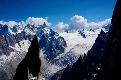 A view high on the route of the Aiguilles du Roc in the foreground and the Deant Geant, Pointe Hellbronner and the Vallee Blanche in the background.