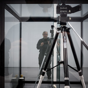 Damien Hirst, 1992, The Asthmatic Escaped II. Two glass boxes contain a camera on a tripod, a saucer, biscuits, film, a plastic cup and lid, jeans, a t-shirt, trainers, and an inhaler. The work is a monument to the painter Francis Bacon, an asthmatic, who passed away the same year Hirst created this piece.