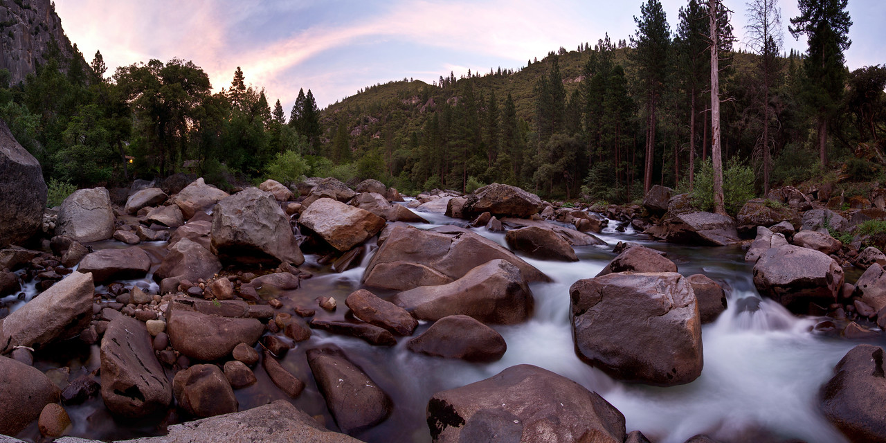 "Yosemite River Sunset<br /> A panoramic photo of a sunset in Yosemite National Park.<br /> Purchase this photo at the top right by clicking ""buy"".<br /> 1x2 panoramic format<br /> 40""x80"" Max printing size. <br /> Displayed at 12""x24"""