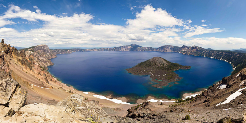 "Crater Lake<br /> A panoramic photo of Crater Lake in the summer. <br /> Purchase this photo at the top right by clicking ""buy"".<br /> 1x2 panoramic format<br /> 20""x40"" Max printing size.<br /> Displayed at 12""x24"""