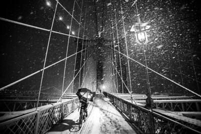 NY_SnowyBridge_BikeRider
