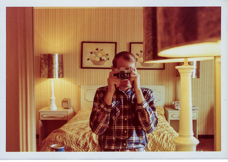 Taken in a Washington DC hotel room summer of 1976 with a Canon AE-1 this is a selfie of me through a mirror in the room.