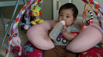 Holding the bottle.