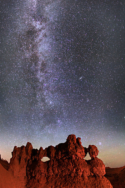 Stars and Milky Way behind 'The Mask' - Bryce Canyon National Park. This is the northern end of the Milky Way, with many constellations like the Paleiades, or Seven Sisters (star cluster just above right eyebrow of The Mask).