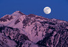 Moon rising at dusk over Wasatch Mountains in Northern Utah.