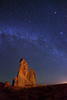 Milky Way stars over 'The Organ' in Arches National Park. The Organ has been light painted from a distance of about 700 feet by a single, stationary quartz halogen light (from camera right). The glow on the right horizon is from the moon, which will rise in another 30 minutes. Camera direction is northeast.