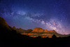 "Milky Way stars over Zion National Park. Springdale, Utah is the entrance to Zion National Park, and is surrounded on both sides by the the park. The mountains are illuminated by the reflected lights from this small town. The mountain in the center is called ""The Watchman""."