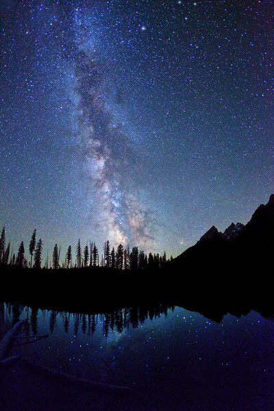 Starry night sky and Milky Way over String Lake and Tetons, Grand Teton National Park.