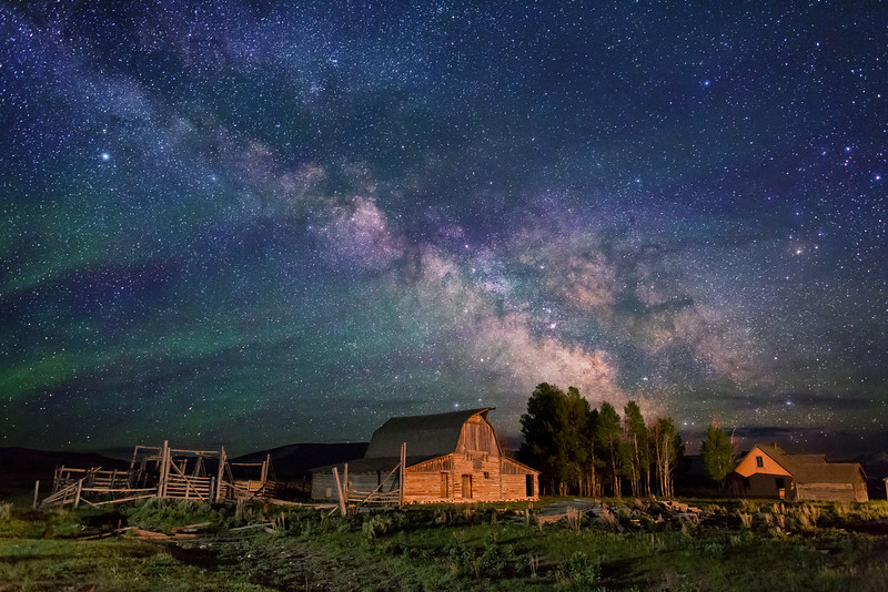 """Milky Way Stars over John Moulton barn and homestead, Grand Teton National Park. Photographed @ 11:30 PM (2.5 hours after sunset). Light Painting added to enhance recognition. This photo was taken from the """"backside"""" of the barn in order to line up with the Milky Way at this season of the year."""