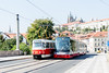 Old and new trams pass over bridge