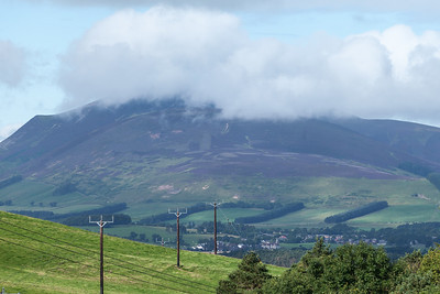 Clouds hover above the hills by Biggar