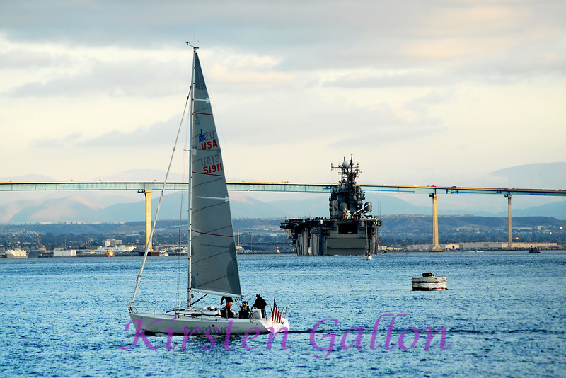 A carrier heads toward the Coronado Bay Bridge.  From my vantage point it appears it is going to hit the bridge.
