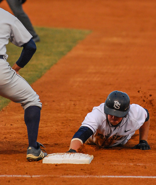 Collegian Photo By: Jimmy Dever Penn State's Mike Deese slides back to first base against Bucknell Tuesday night.