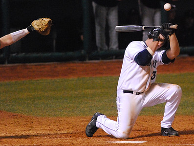 Collegian Photo By: Jimmy Dever Penn State Senior Mike Deese is hit in the helmet attempting to bunt Tuesday night versus Bucknell.