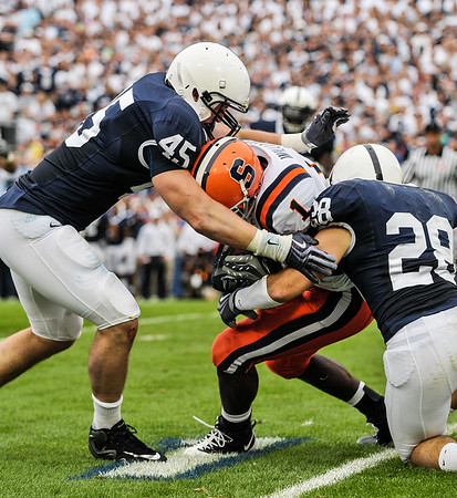 Collegian Photo By: Jimmy Dever Sean Lee (45) and Drew Astorino (28) tackle Mike Williams (1) during Penn State's victory over Syracuse.