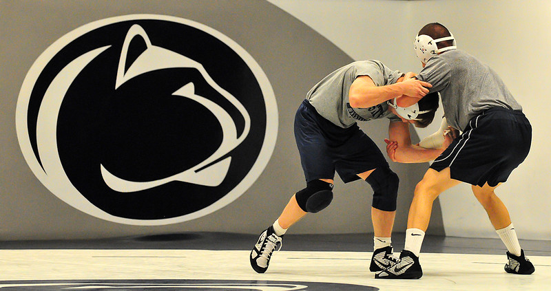 Collegian Photo By: Jimmy Dever Brad Pataky (left) and Eric Caschera (right) wrestle each other at practice Wednesday.