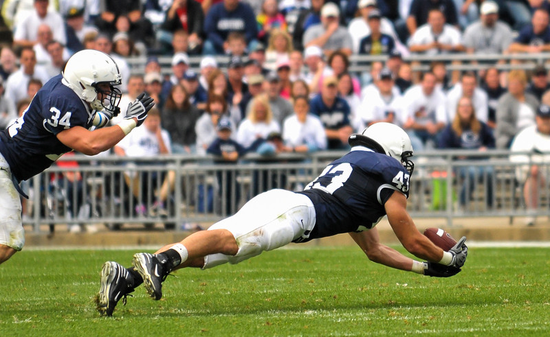 Collegian Photo By: Jimmy Dever Linebacker Josh Hull recovers the tipped pass in the fourth quarter of Saturday's game against Syracuse.