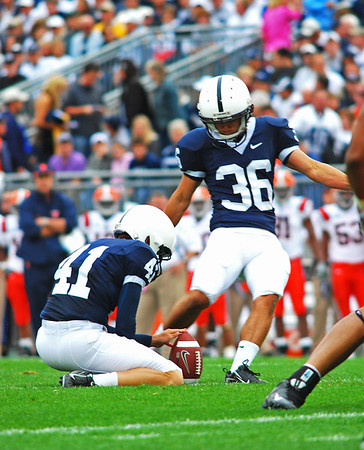 Collegian Photo By: Jimmy Dever Kyle Johnson kicks the extra point after Penn State's first touchdown during Saturday's victory over Syracuse.