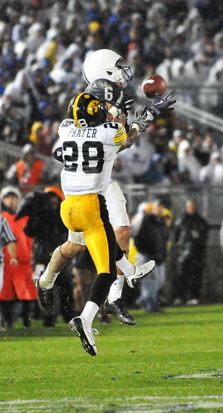 Collegian Photo By: Jimmy Dever Penn State Wide Reciever Derek Moye (6) jumps for a pass Saturday over Iowa's Shaun Prater (28).