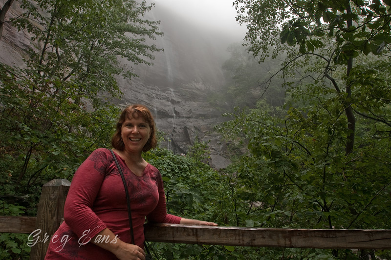 Angie with waterfall in background at Chimney Rock.
