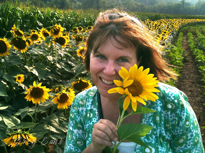 Angie with sunflower at the Biltmore in Asheville, NC.