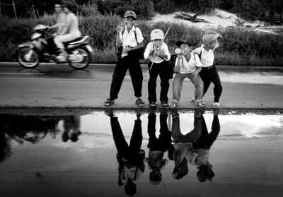 15/10/02........Pic Paul Chappells Daily Record.....Vietnamese boys play up for the camera outside Ho Chi Minh City....as part of a travel feature.