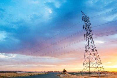 Power line transmission tower at sunrise