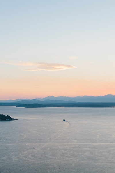 Aerial view of Washington State ferry and Pugest Sound at sunset