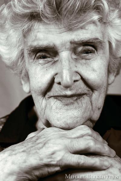 Headshot of an elder woman in sepia tone