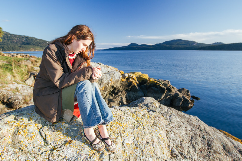Woman relaxing on the coast