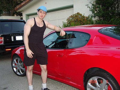 Leo with a red car