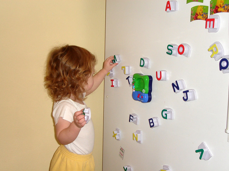 Learning her letters with her new Fridge Phonics.