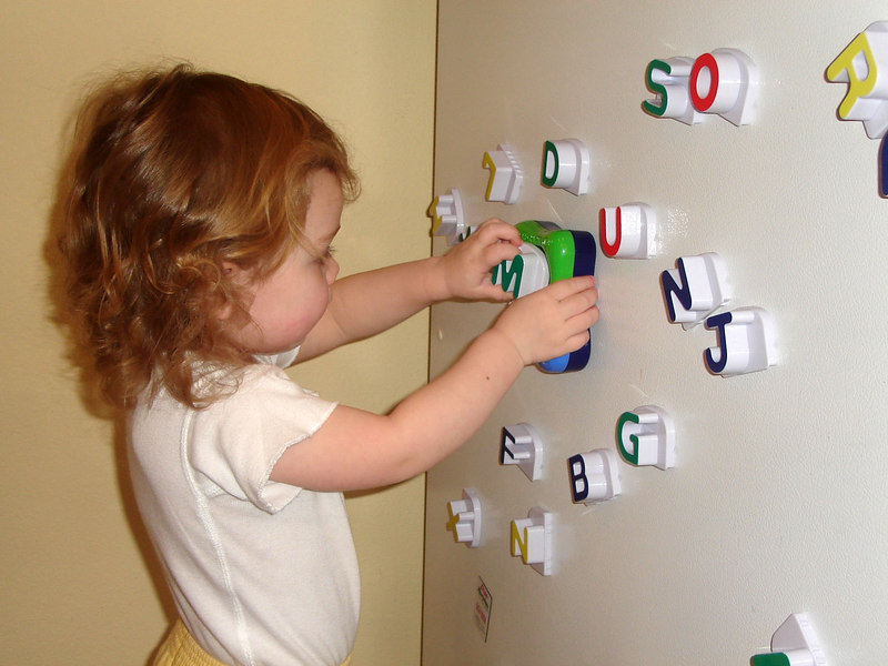 Learning her letters with Fridge Phonics.
