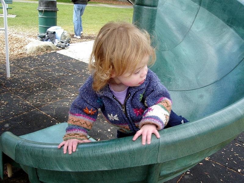 Climbing up the slide at Jennings Park