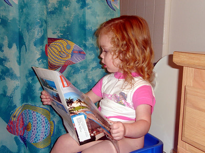 reading on the toilet, just like her daddy