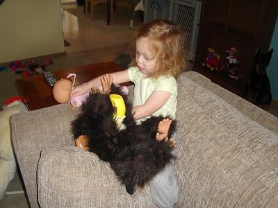 Feeding her monkey a bottle.