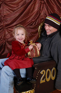 The real picture of Kimber on Santa Daddy's lap. She refused to go anywhere near Santa so the photographer took a picture of her sitting on my lap, then a picture of just Santa in the chair and finally digitally pasted Kimber's image on to Santa's lap (previous picture). :)