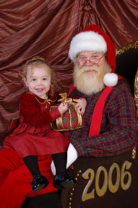 The digitized version of Kimber on Santa's lap. She refused to go anywhere near Santa so the photographer took a picture of her sitting on my lap (next picture), then a picture of just Santa in the chair and finally digitally pasted Kimber's image on to Santa's lap. :)