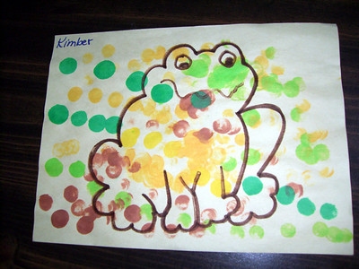 A frog that Kimber colored with different stamps at daycare.