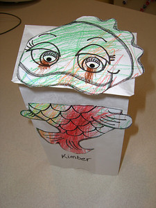 A fish puppet that she colored and glued together.