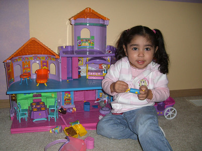 Natalie at Kimber's birthday party, playing with Dora's castle.