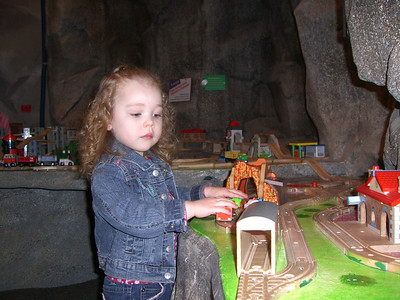 Playing with the wooden train/car tracks - at the Everett Children's Museum.