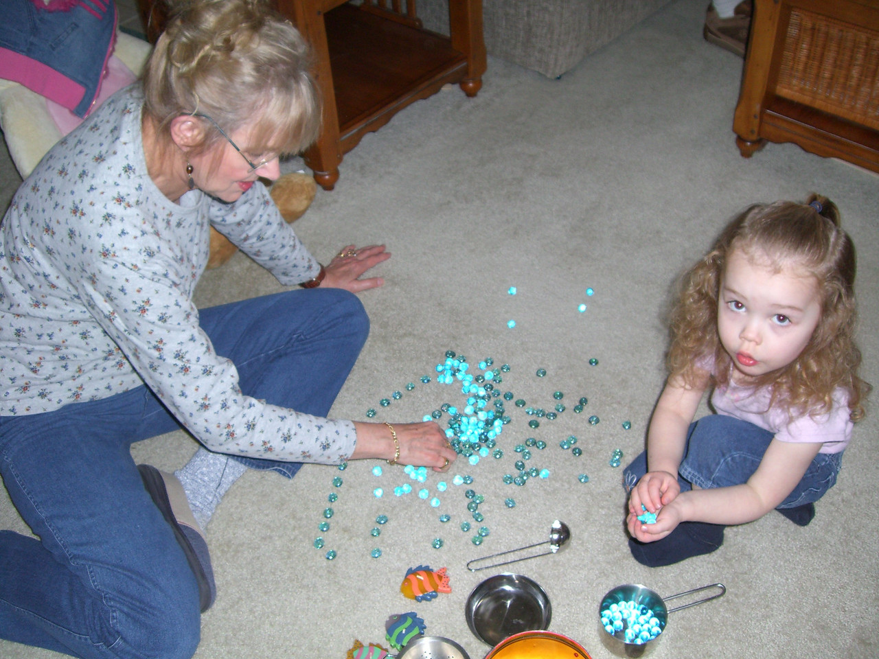 Making snakes (curvy lines) out of marbles with Grandmama.