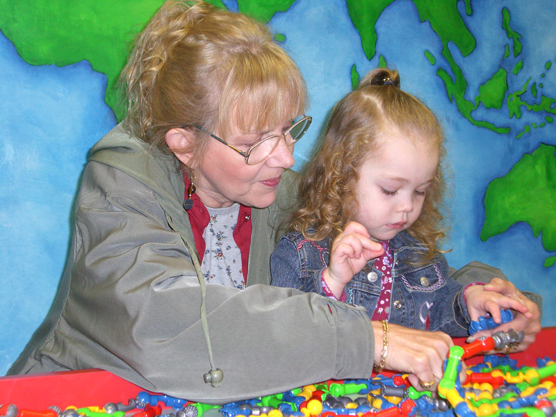 Grandmama helping Kimber put something together - at the Everett Children's Museum.