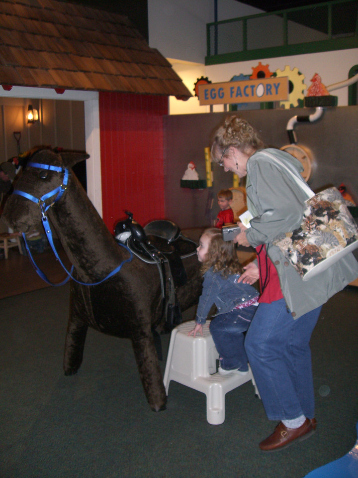 Riding the horse - at the Everett Children's Museum.