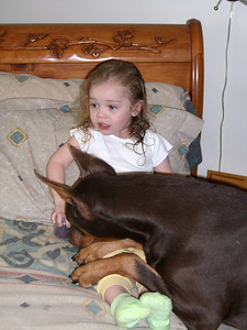 Kimber and Slone together on the bed.