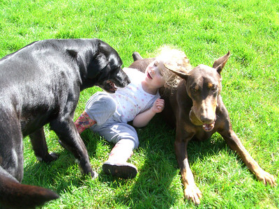 Kimber playing with Malcolm and Slone in the backyard on Easter morning.